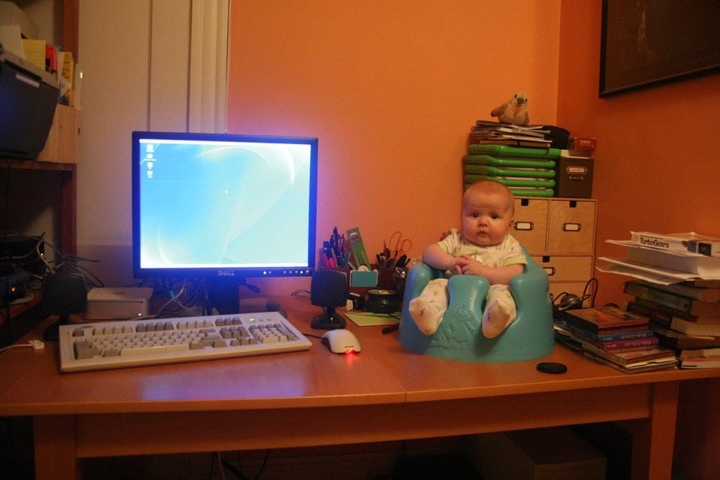 baby sitting on desk