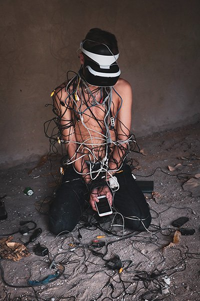 Man tangled in cables.